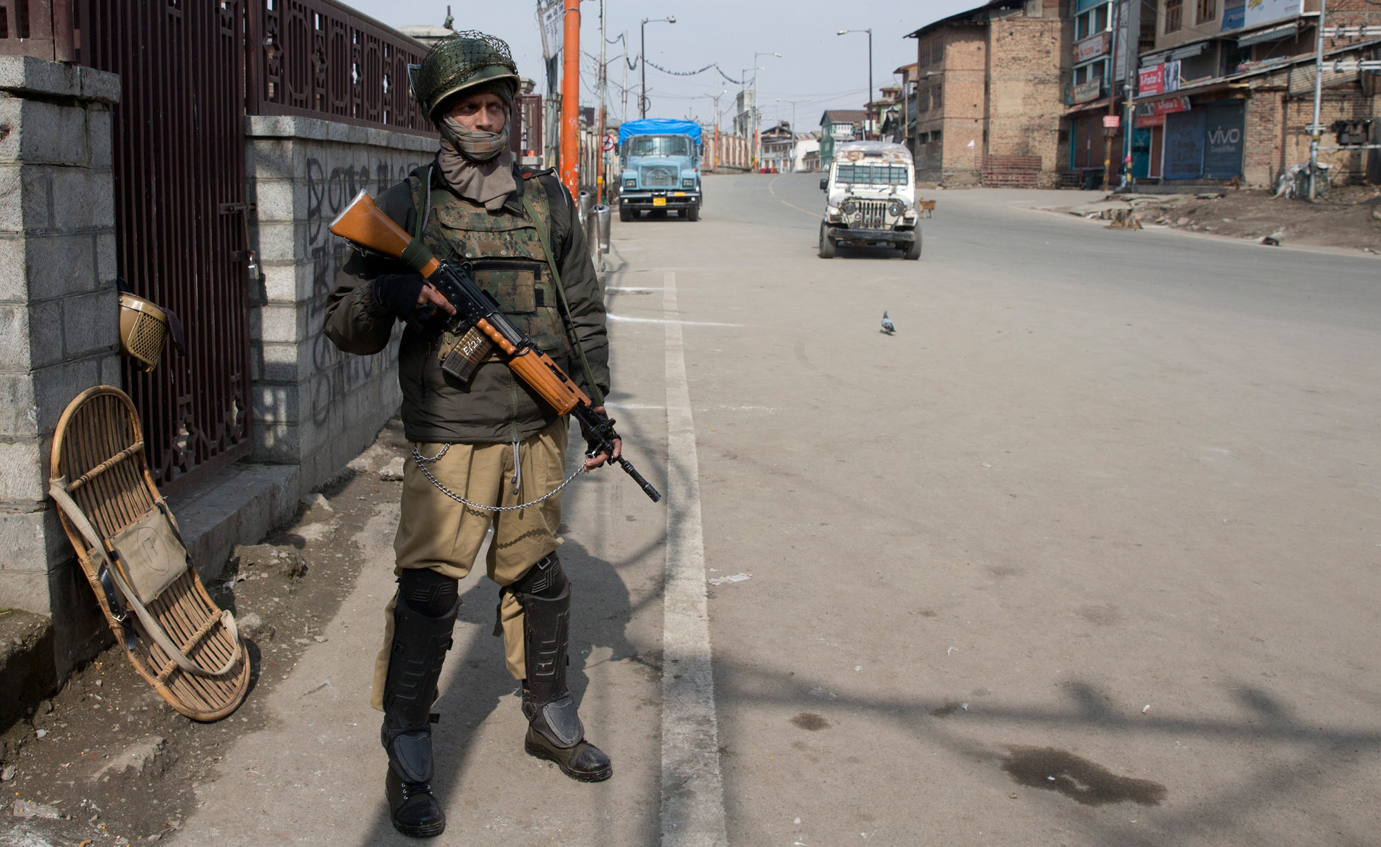 An Indian paramilitary soldier stands guard during security lockdown in Srinagar on Sunday, February 24, 2019.