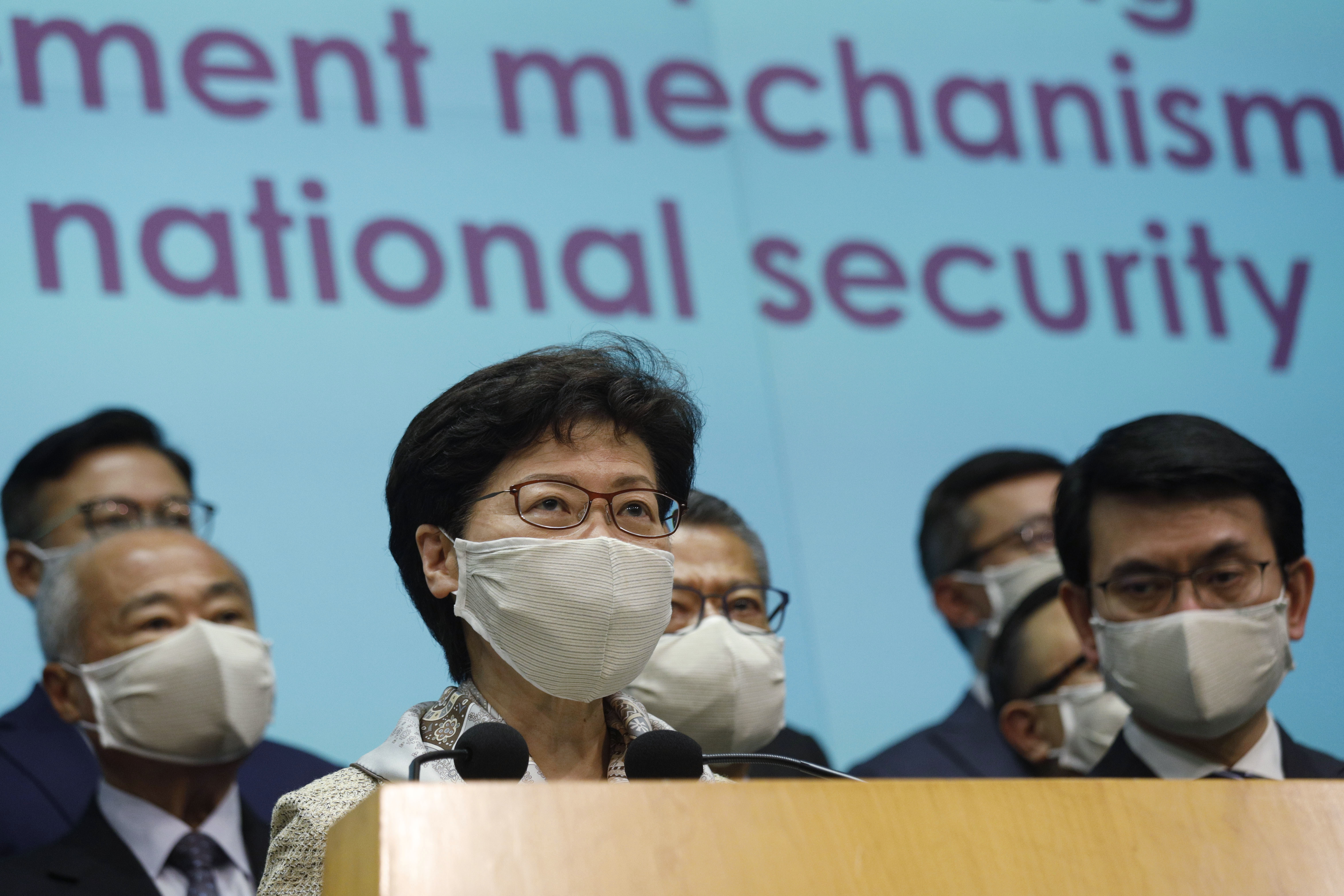 Carrie Lam and other officials attend a news conference in Hong Kong after returning from China's National People's Congress (NPC) meeting in Beijing