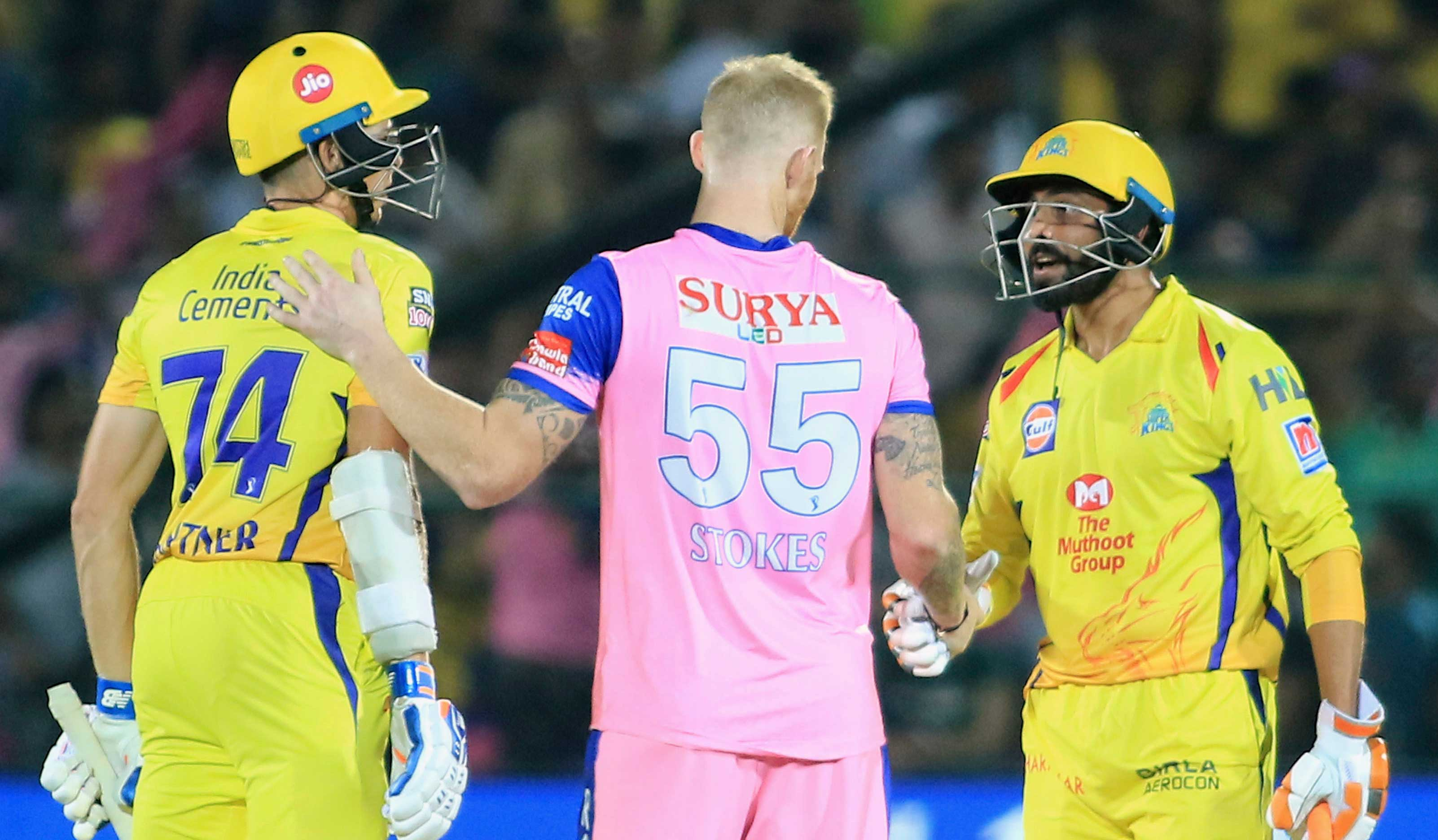 Chennai Super Kings' Ravindra Jadeja, right, and Mitchell Santner, left, speak with Rajasthan Royals' Ben Stokes during the IPL T20 cricket match between their teams in Jaipur on Thursday, April 11, 2019