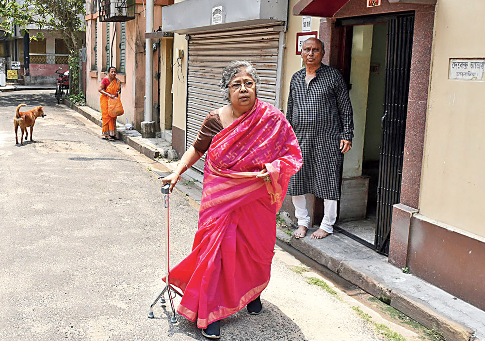 Sipra Bose and her husband in a bylane off Swinhoe Street in front of their house. A car is parked in front of their garage making it difficult for them to take out their car.