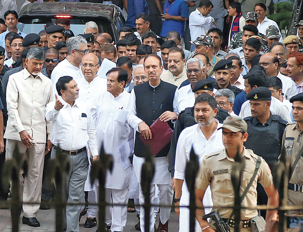 Chandrababu Naidu, Congress leaders Ghulam Nabi Azad and Ahmed Patel and other Opposition leaders after meeting the Election Commission.