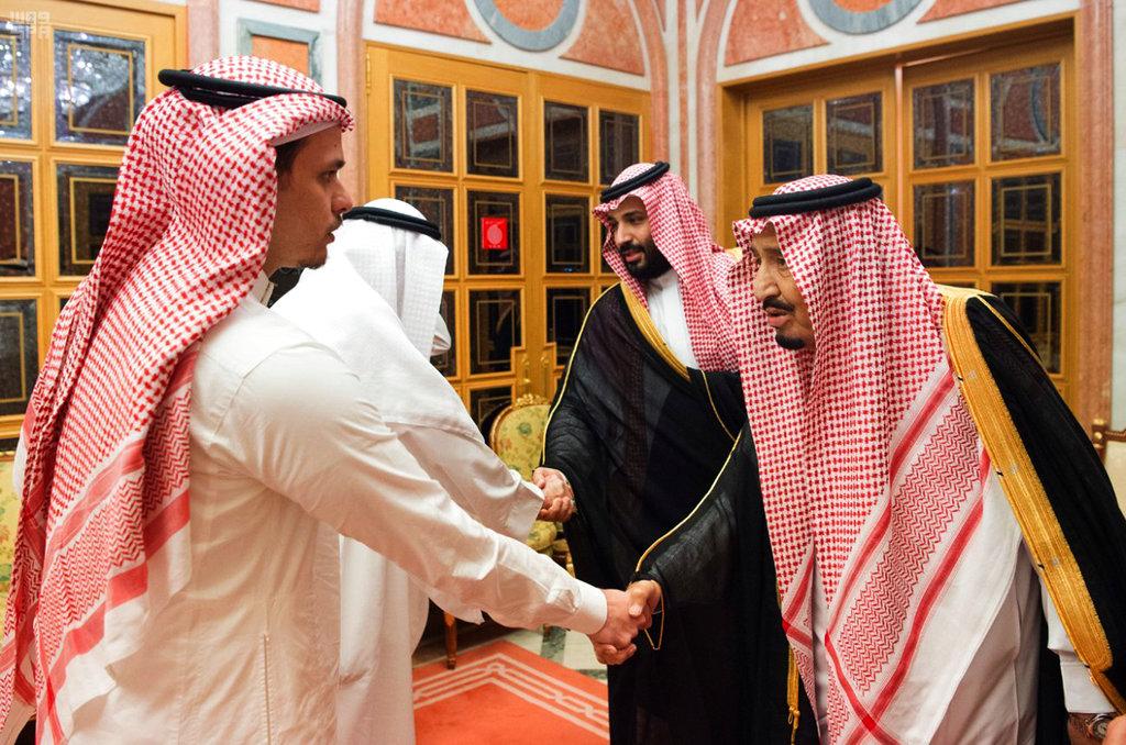 Saudi Crown Prince Mohammed bin Salman, shakes hands with Salah Khashoggi, a son, of Jamal Khashoggi, in Riyadh, Saudi Arabia on October 23, 2018.