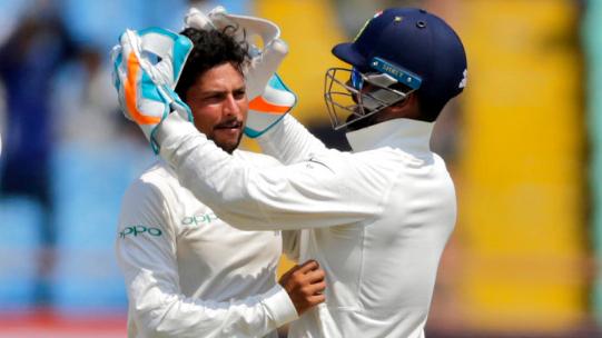 Kuldeep Yadav of India celebrates after the dismissal of West Indies' Shai Hope in Rajkot
