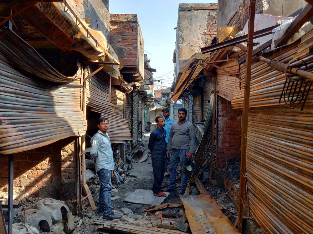A row of shops destroyed by mobs during last weeks violence in northeast Delhi