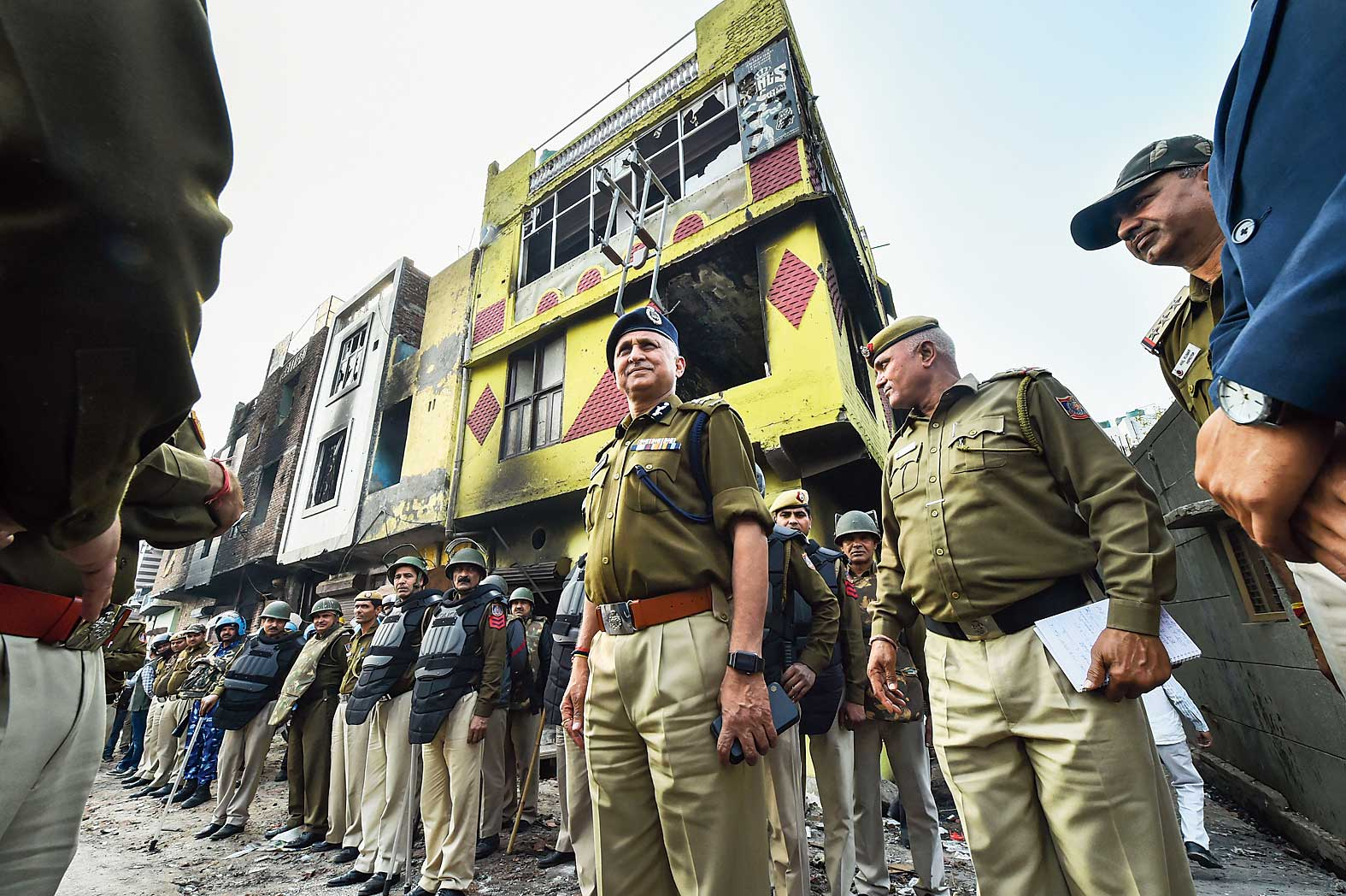 Delhi police commissioner SN Srivastava with other offciers at Shiv Vihar, one of the riot-affected areas, in northeast Delhi, on Monday.