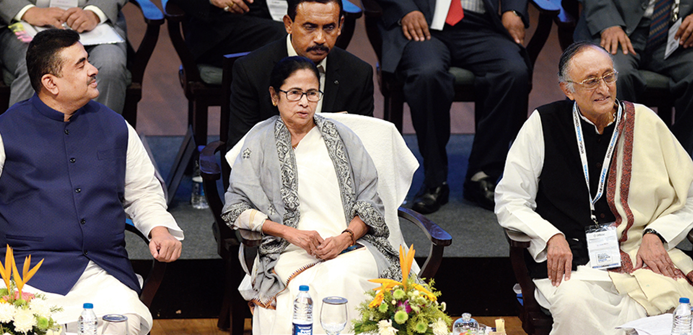(From left) Transport minister Suvendu Adhikari, Mamata Banerjee and Amit Mitra on the last day of the business summit in Digha on Thursday.