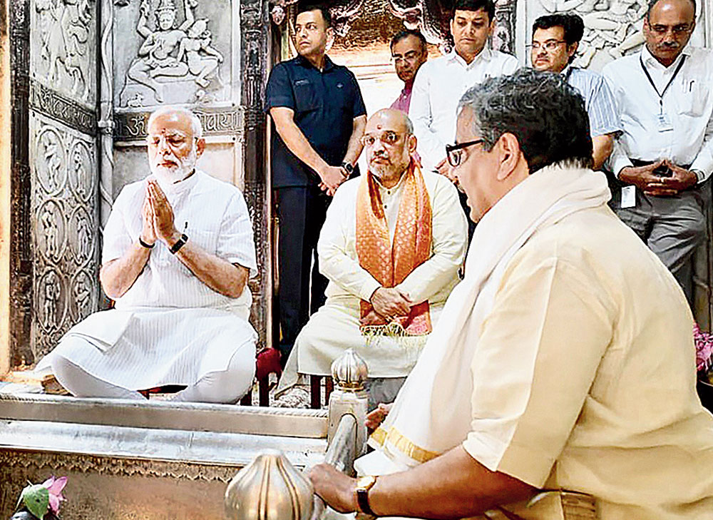 Prime Minister Narendra Modi, along with BJP president Amit Shah, offers prayers at the Kashi Vishwanath temple in Varanasi