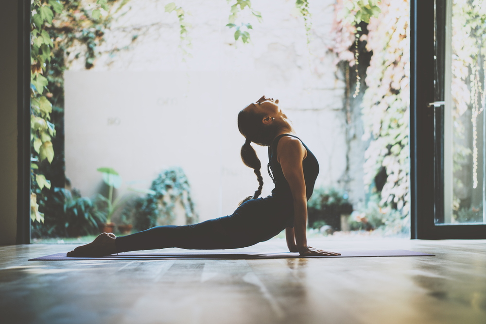 Check out some exercise videos on YouTube, or just put on music and dance. Combine it with a 30 minute yoga session, three times a week.