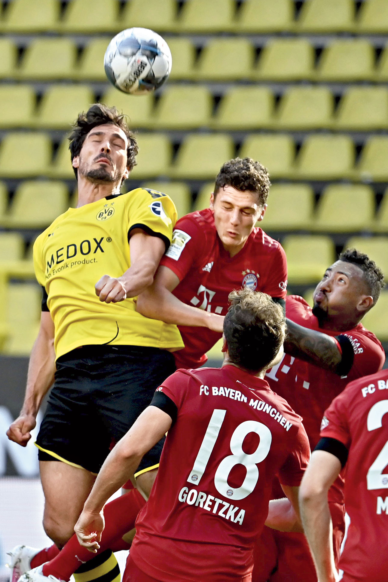 Borussia Dortmund's Mats Hummels (left) and Benjamin Pavard of Bayern Munich in an aerial tussle during a Bundesliga match in Dortmund on Tuesday.