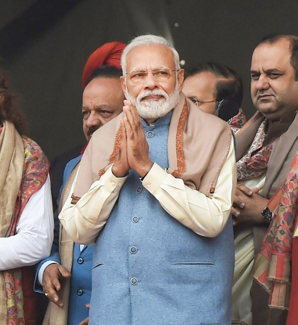 Prime Minister Narendra Modi with BJP leaders during a rally at Ramlila Maidan, in New Delhi, Sunday, December 22, 2019.