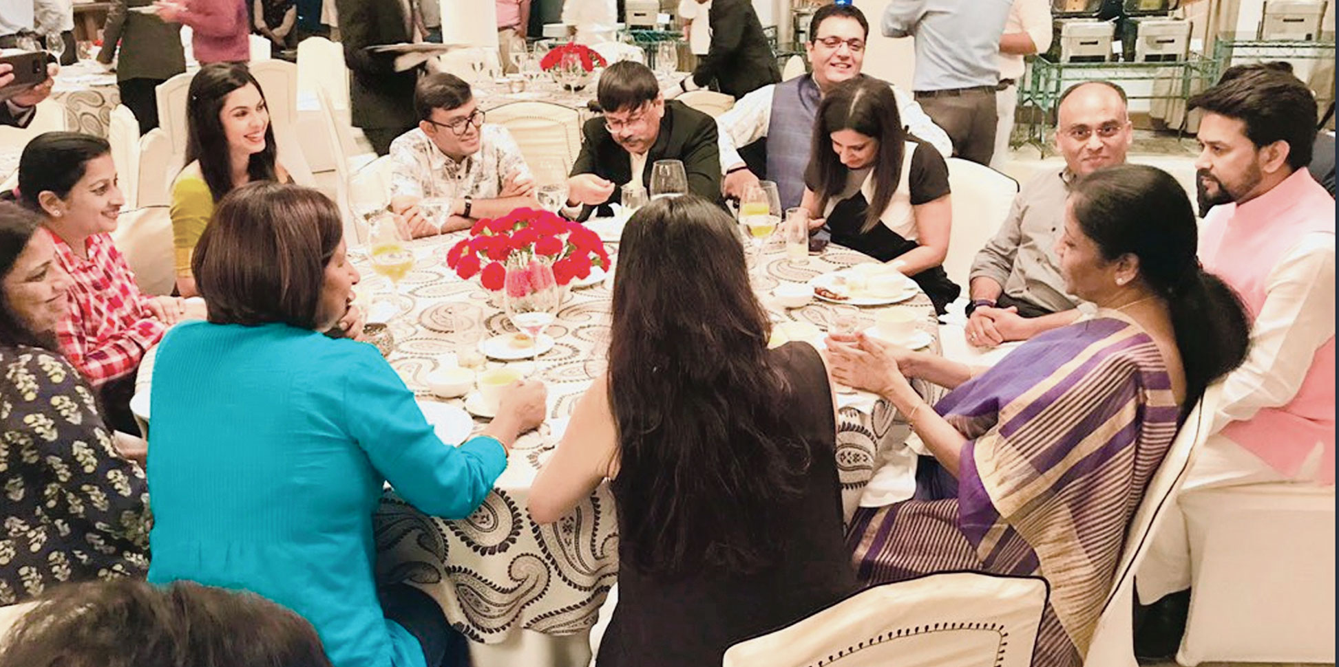 A picture tweeted by junior finance minister Anurag Thakur on July 12 shows him and Nirmala Sitharaman interacting with some of those who attended the dinner