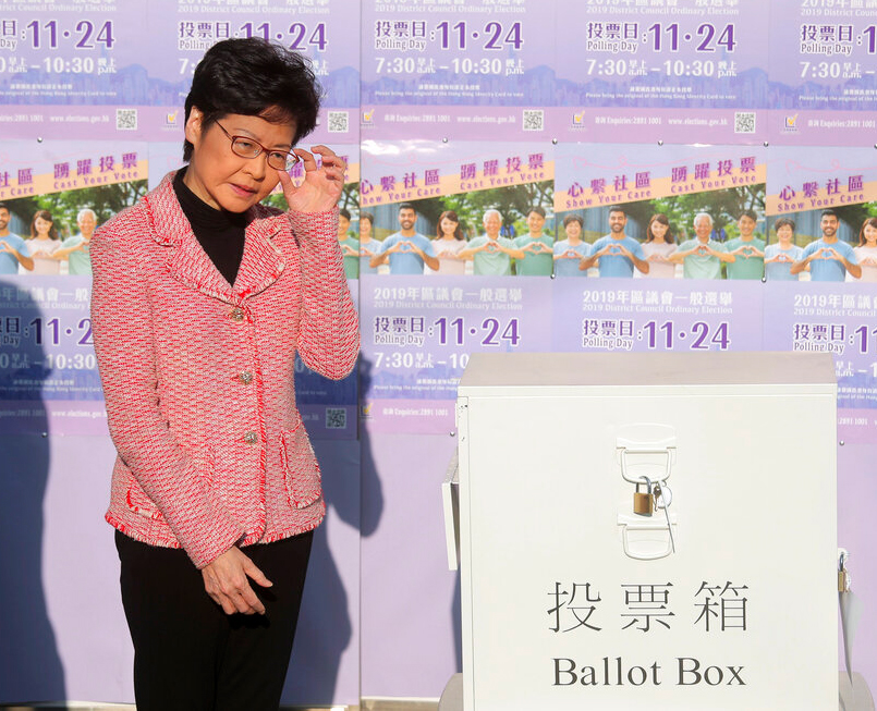 Hong Kong Chief Executive Carrie Lam casts her ballot at a polling place in Hong Kong, Sunday, Nov.ember 24, 2019.