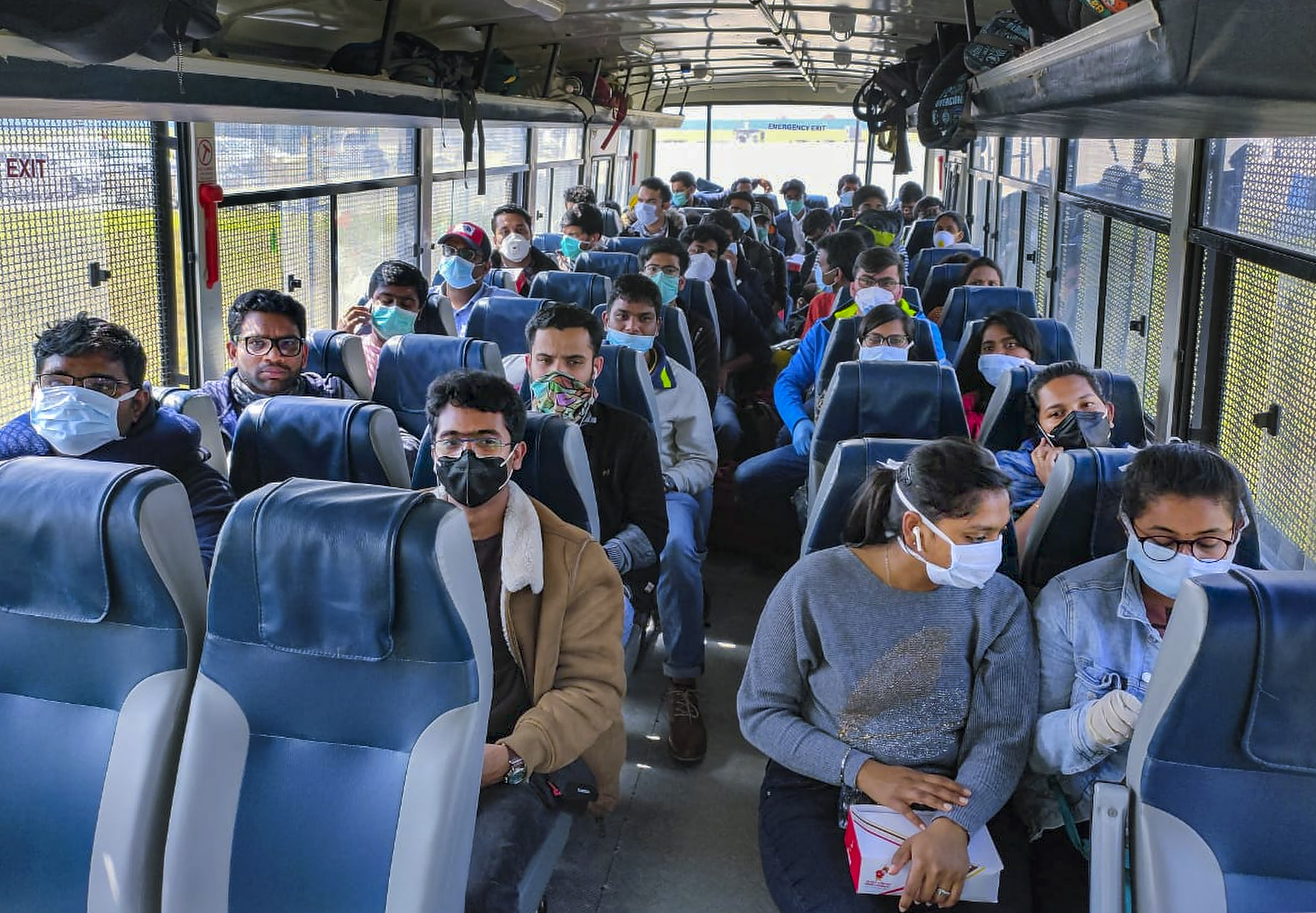 In this handout photo provided by ITBP, evacuees airlifted from Rome, Italy in the wake of coronavirus pandemic, on their arrival at IGI airport, before being sent to a quarantine facility in New Delhi, Sunday, March 22, 2020