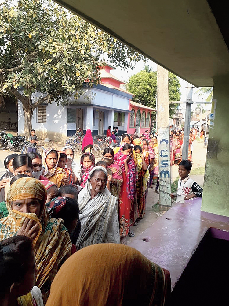 Women queue up in front of a customer service point at Mallarpur in Birbhum on Friday