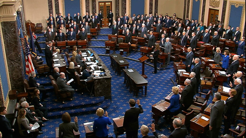 Presiding officer Supreme Court Chief Justice John Roberts swears in members of the Senate for the impeachment trial against President Donald Trump at the U.S. Capitol in Washington