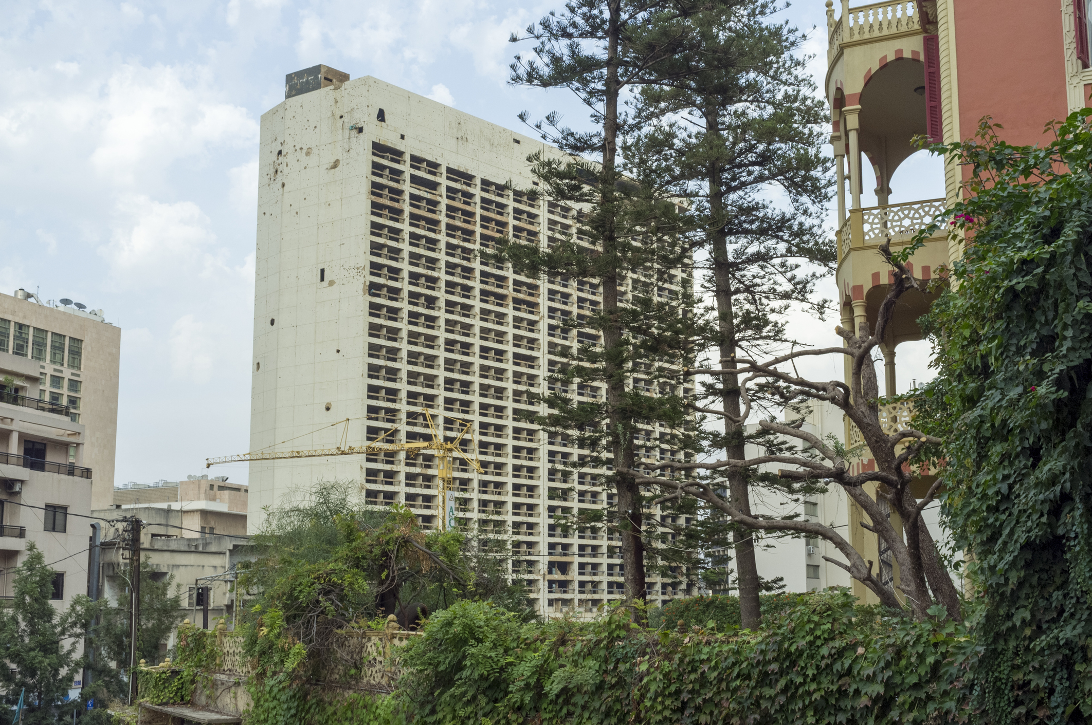 The old Holiday Inn building – bullet-riddled and bomb-shattered. The once-plush hotel in downtown Beirut opened just two years before the civil war broke out