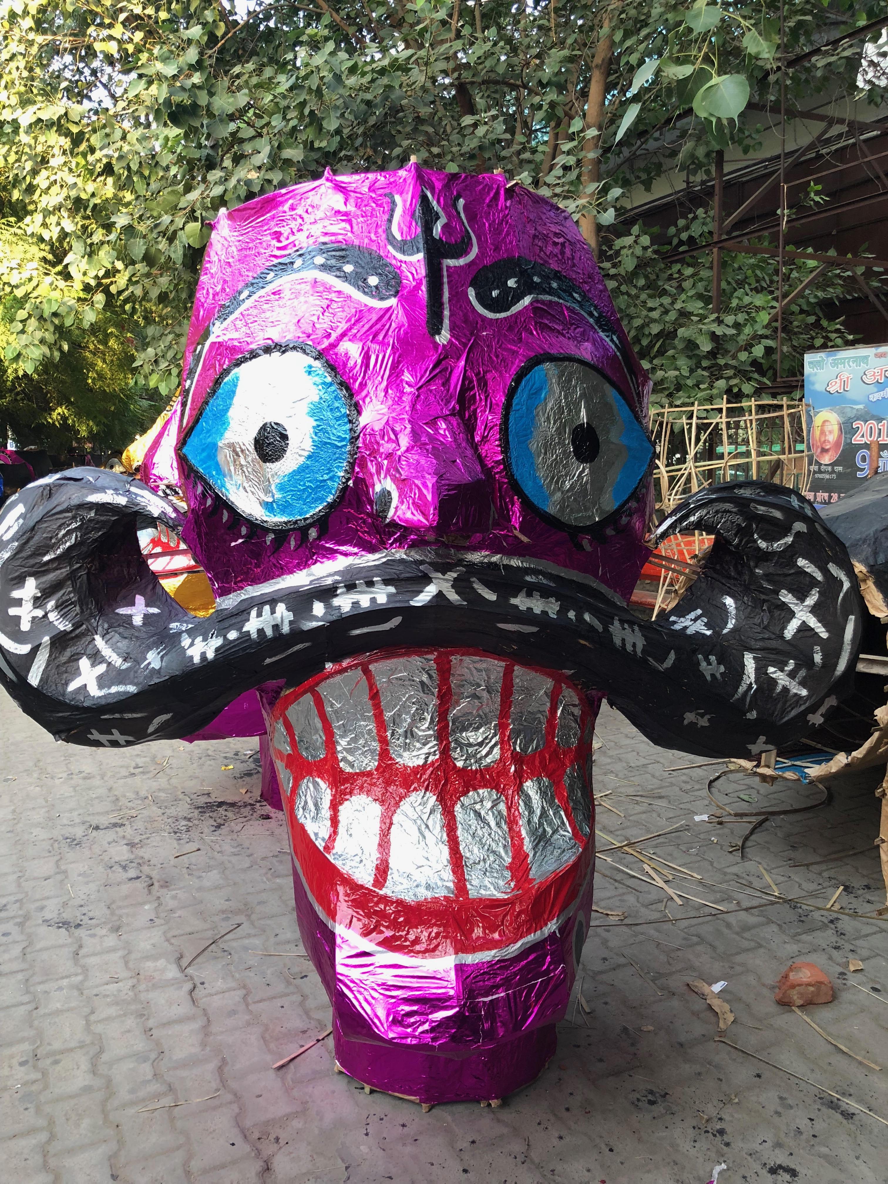 Raavan head on the pavement near Tagore Garden metro station