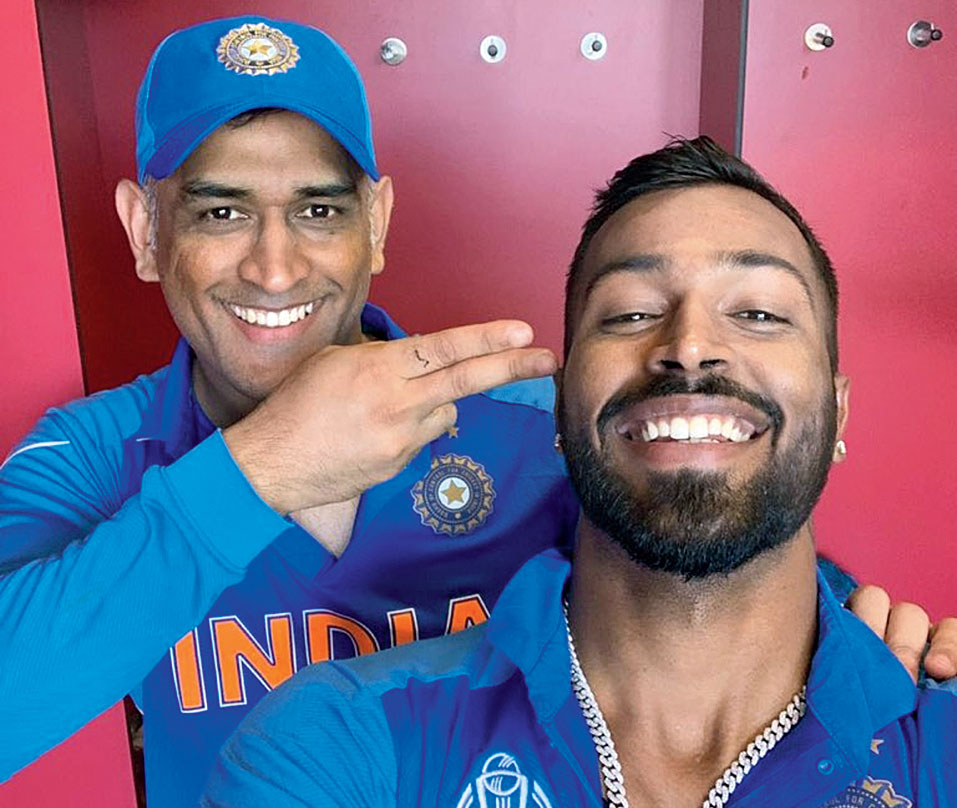 Mahendra Singh Dhoni shares a laugh with Hardik Pandya after the win on Thursday