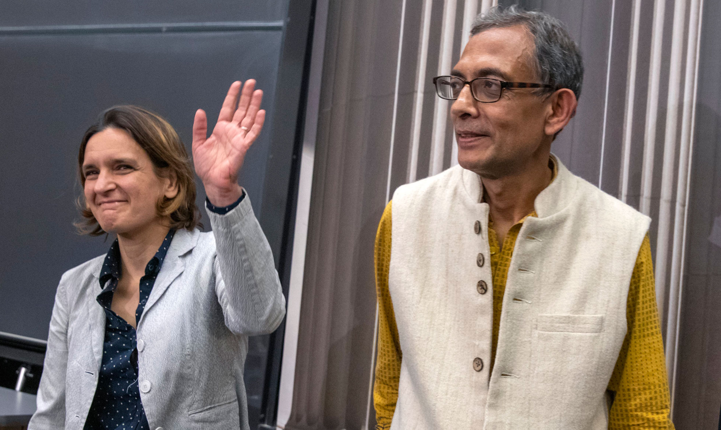 Abhijit Banerjee and Esther Duflo after a news conference at Massachusetts Institute of Technology in Cambridge on October 14.
