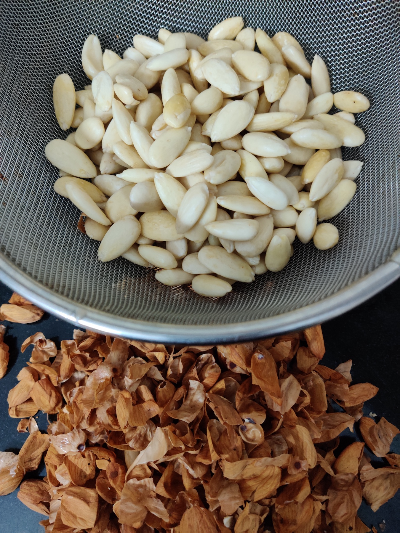 After the almonds have soaked in boiling hot water for a few minutes, the skins should come off easily.