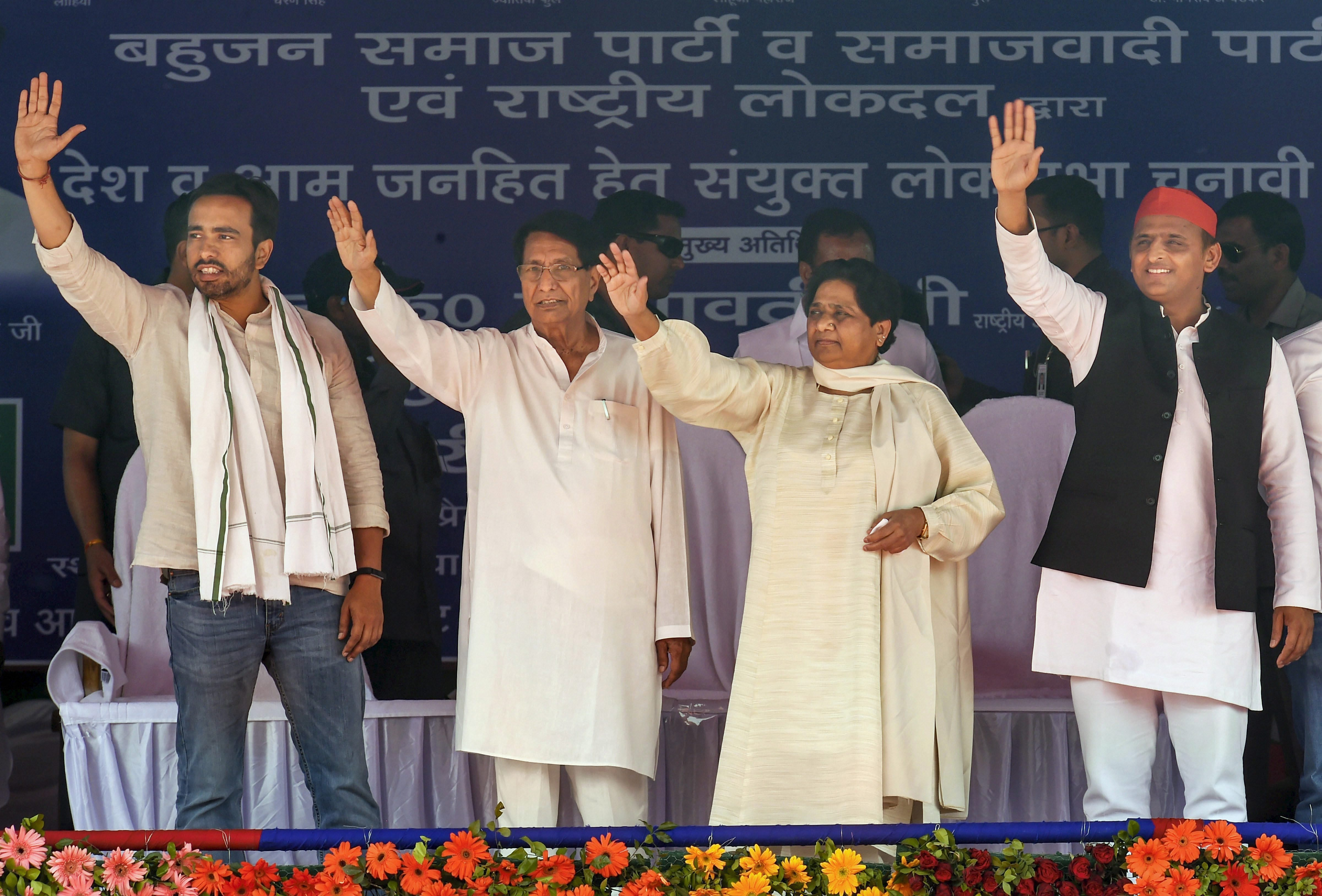 RLD's Jayant Chaudhary and father Ajit Singh with BSP chief Mayawati an Samajwadi Party president Akhilesh Yadav at their joint election rally in Deoband, Saharanpur, on April 7.