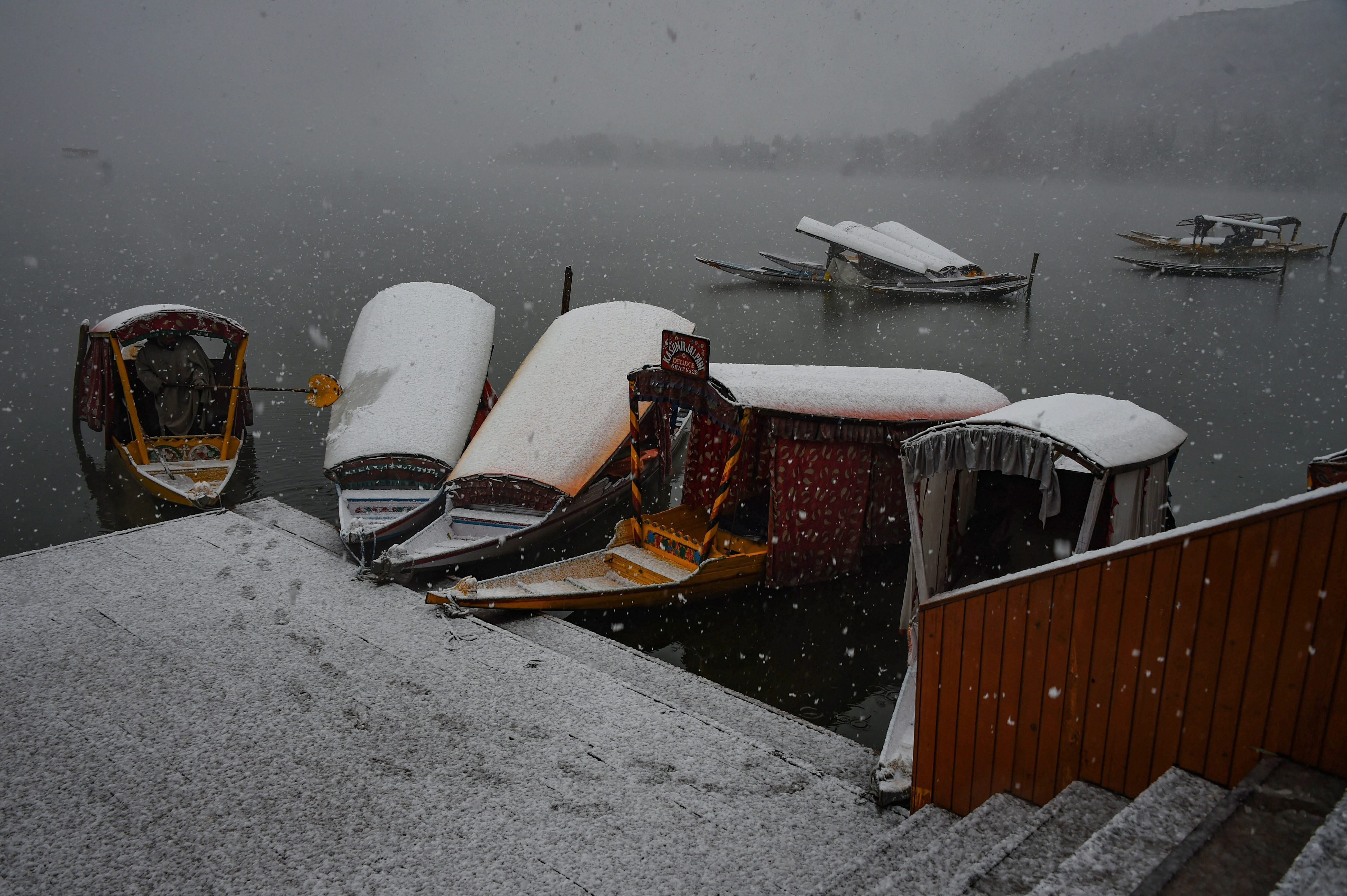 Shikaras covered in snow in Srinagar.