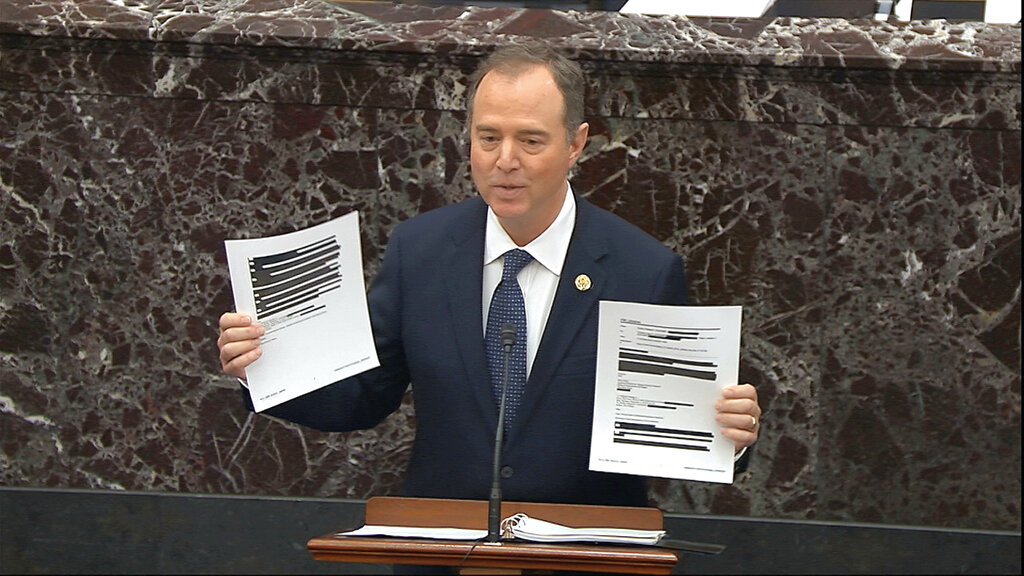 In this image from video, House impeachment manager Rep. Adam Schiff, D-Calif., holds redacted documents as he speaks during the impeachment trial against President Donald Trump in the Senate at the U.S. Capitol in Washington, January 2020.