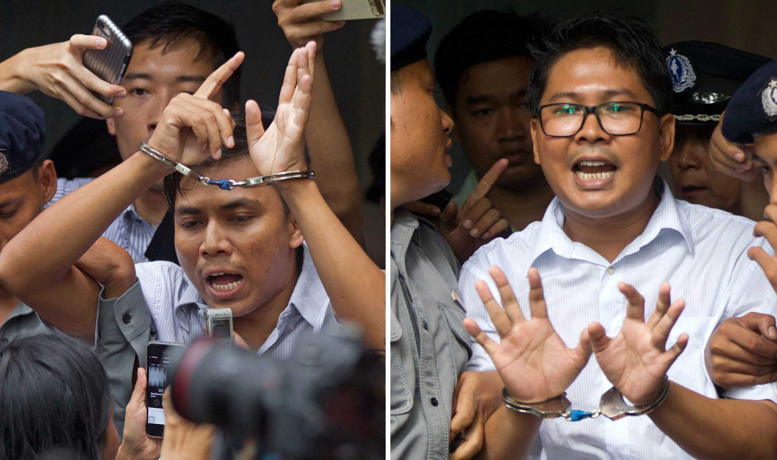 Reuters journalists Kyaw Soe Oo (left) and Wa Lone, are handcuffed as they are escorted out of a court in Yangon, Myanmar, on Septemper 3, 2018