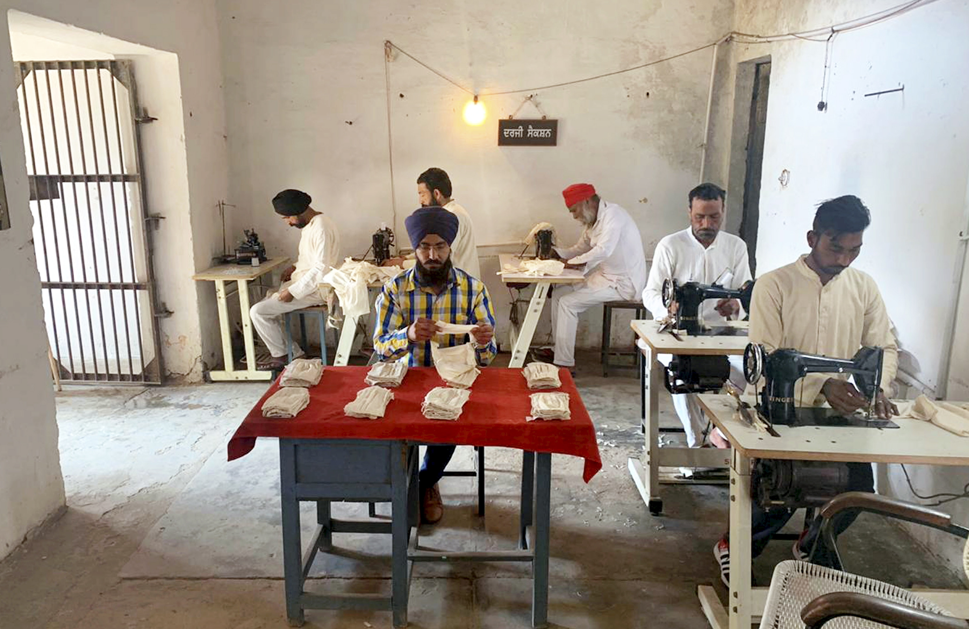 Jail Inmates sew masks for the prison staff in the wake of deadly coronavirus, at Central Jail in Patiala, Sunday, March 29, 2020.