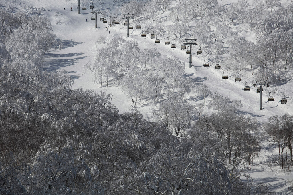 Chairlifts transport skiers at a ski resort Feb. 5, 2020, in Niseko, Hokkaido
