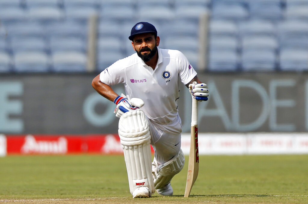 Virat Kohli rests during the second day of the second cricket test match between India and South Africa in Pune, India, on Friday, Oct. 11, 2019.