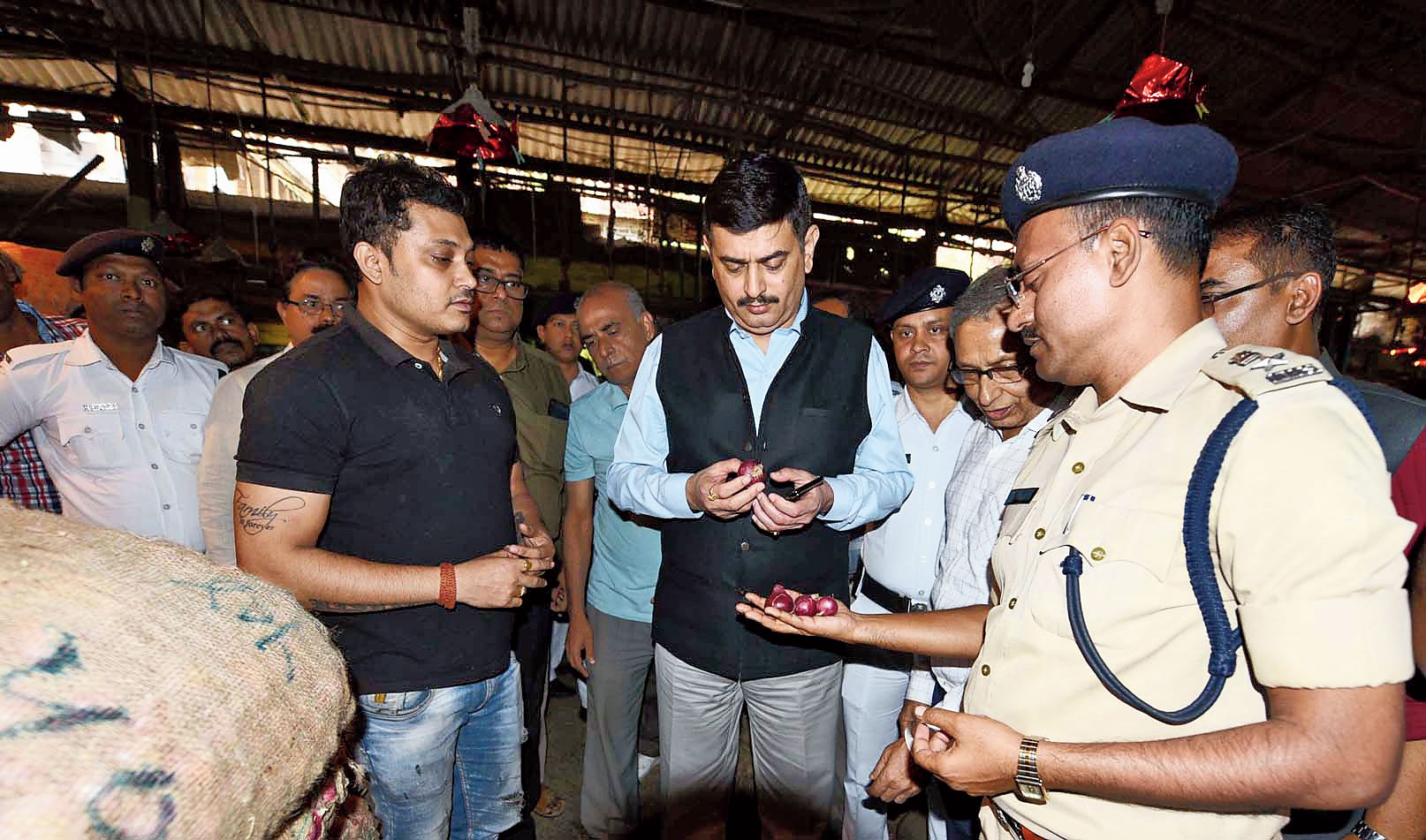 Calcutta police commissioner Anuj Sharma checks onions at Koley Market in Sealdah on Tuesday.