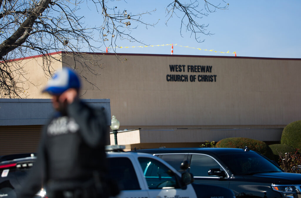 A police officer walks near the scene after a church shooting at West Freeway Church of Christ on Sunday, Dec. 29, 2019 in White Settlement, Texas.