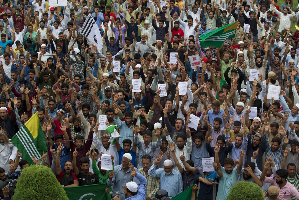 People shout pro-freedom slogans at a demonstration after Friday prayers during curfew-like restrictions in Srinagar on Friday, August 16, 2019
