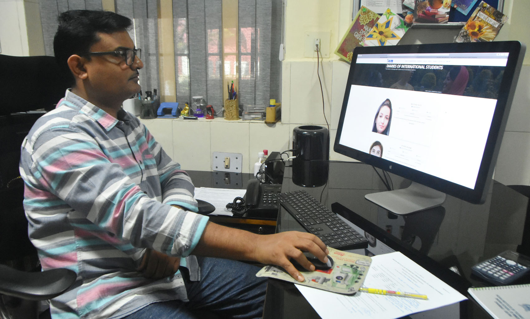 Professor Dheeraj Kumar, Department of Mining Engineering, IIT(ISM), Dhanbad, watches the diaries of international students portal on his computer at his office in on Wednesday, June 24, 2020.