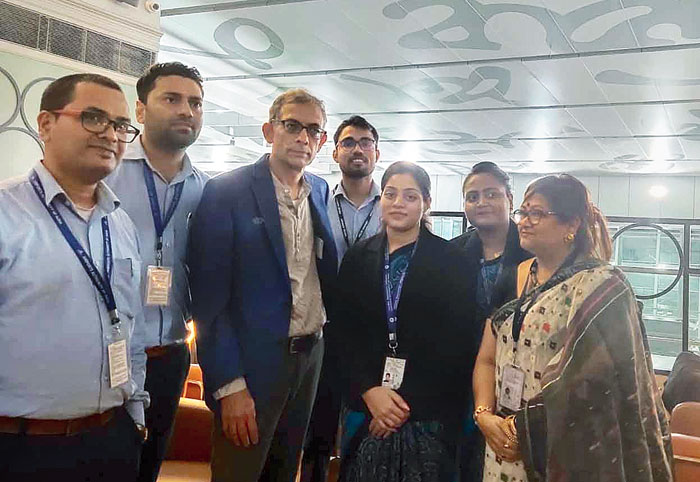 Abhijit Vinayak Banerjee with airport officials and employees at the international business-class lounge of the city airport on Thursday