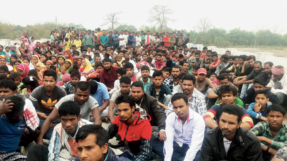 Protesters block the road at Bhutiachang in Udalguri district on Saturday
