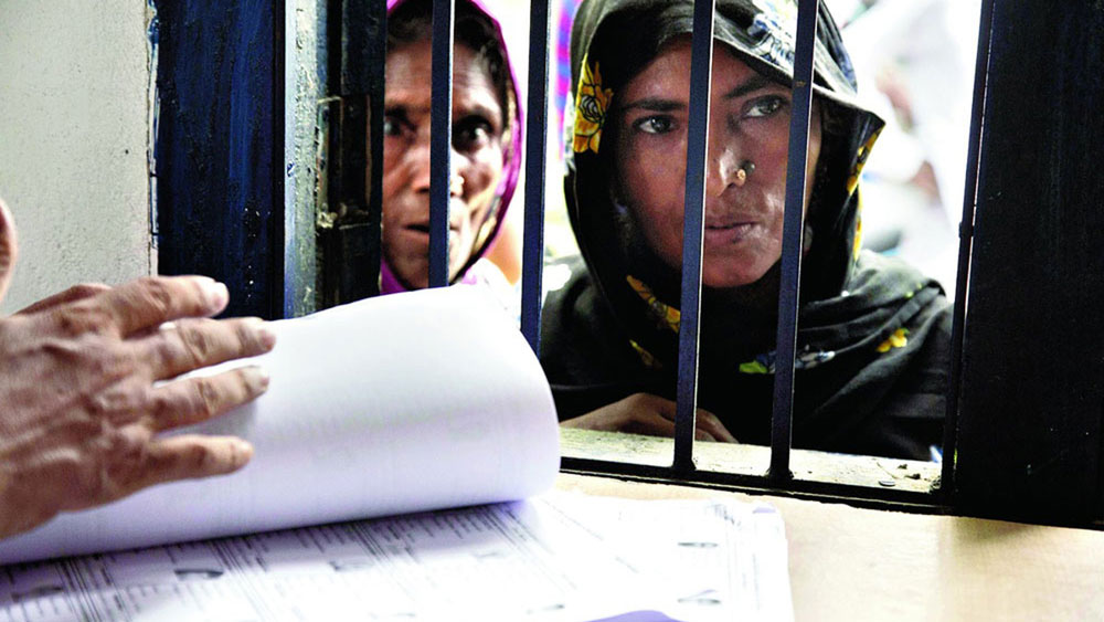 Women at an NRC seva kendra in Mayong, 55km from Guwahati, verify whether their names have been included in the National Register of Citizens