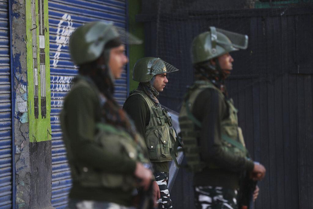 Paramilitary soldiers guard at a closed market in Srinagar, Kashmir, on Aug. 21, 2019.