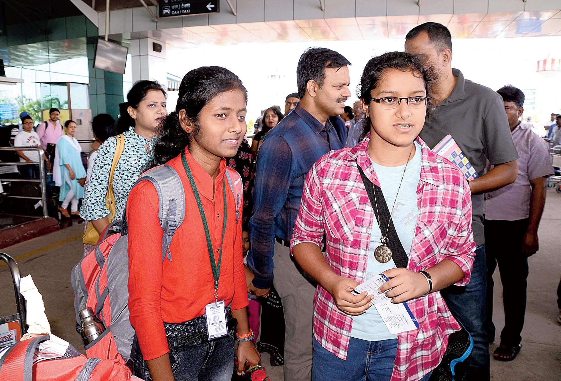 Dhriti Barnwal (right) and Rinki Kumari at Birsa Munda Airport in Ranchi on Sunday.