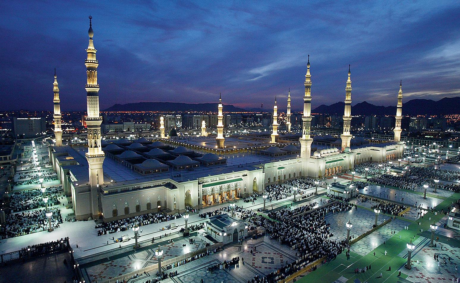 Pilgrims pray near the Prophet Muhammad mosque in the holy city of Medina, Saudi Arabia