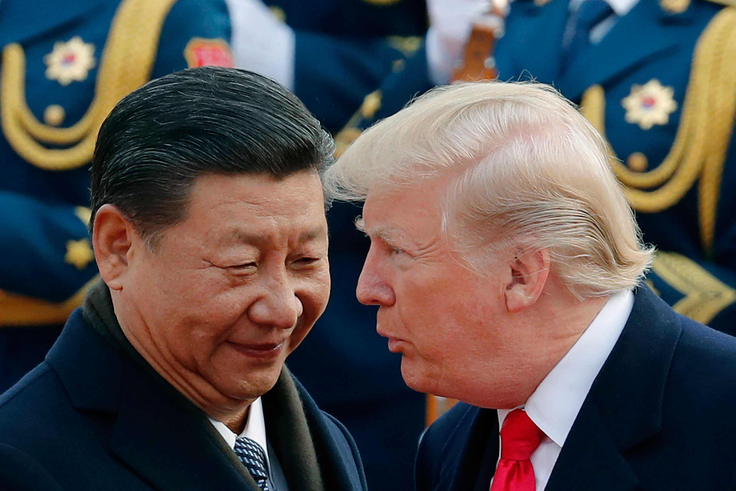 US President Donald Trump chats with Chinese President Xi Jinping during a welcome ceremony at the Great Hall of the People in Beijing.