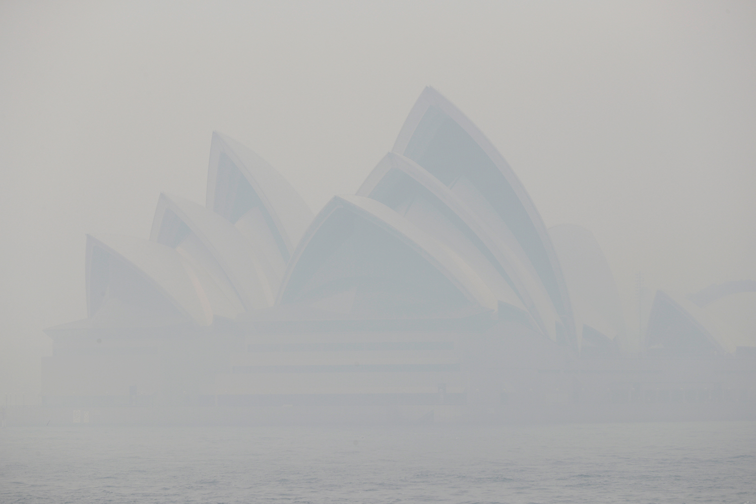Thick smoke from wildfires shroud the Opera House in Sydney on December 10