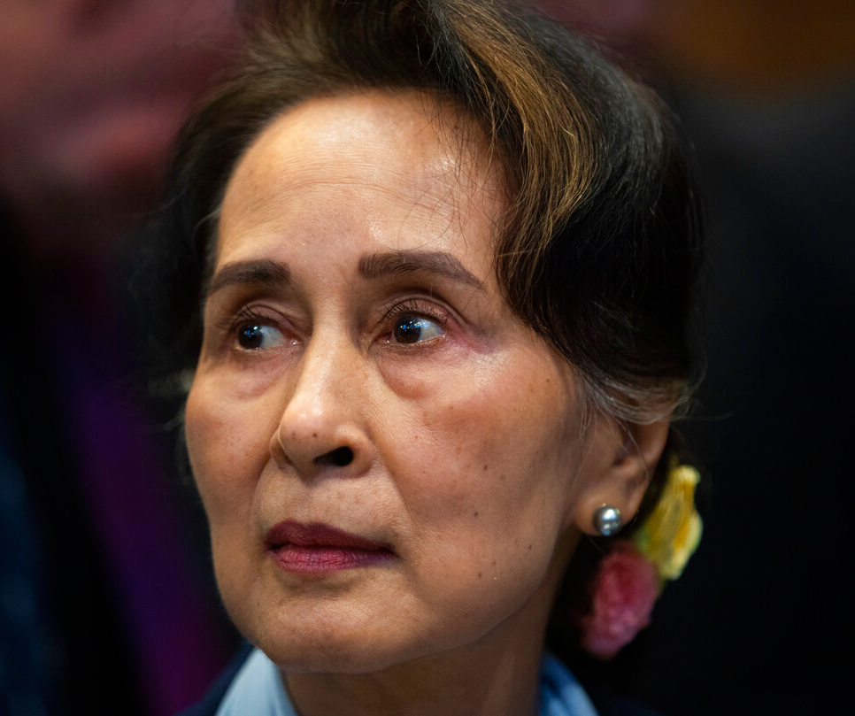 Myanmar's leader Aung San Suu Kyi waits to address judges of the International Court of Justice for the 2nd day of 3 days of hearings in The Hague, Netherlands, Wednesday, December 11, 2019.