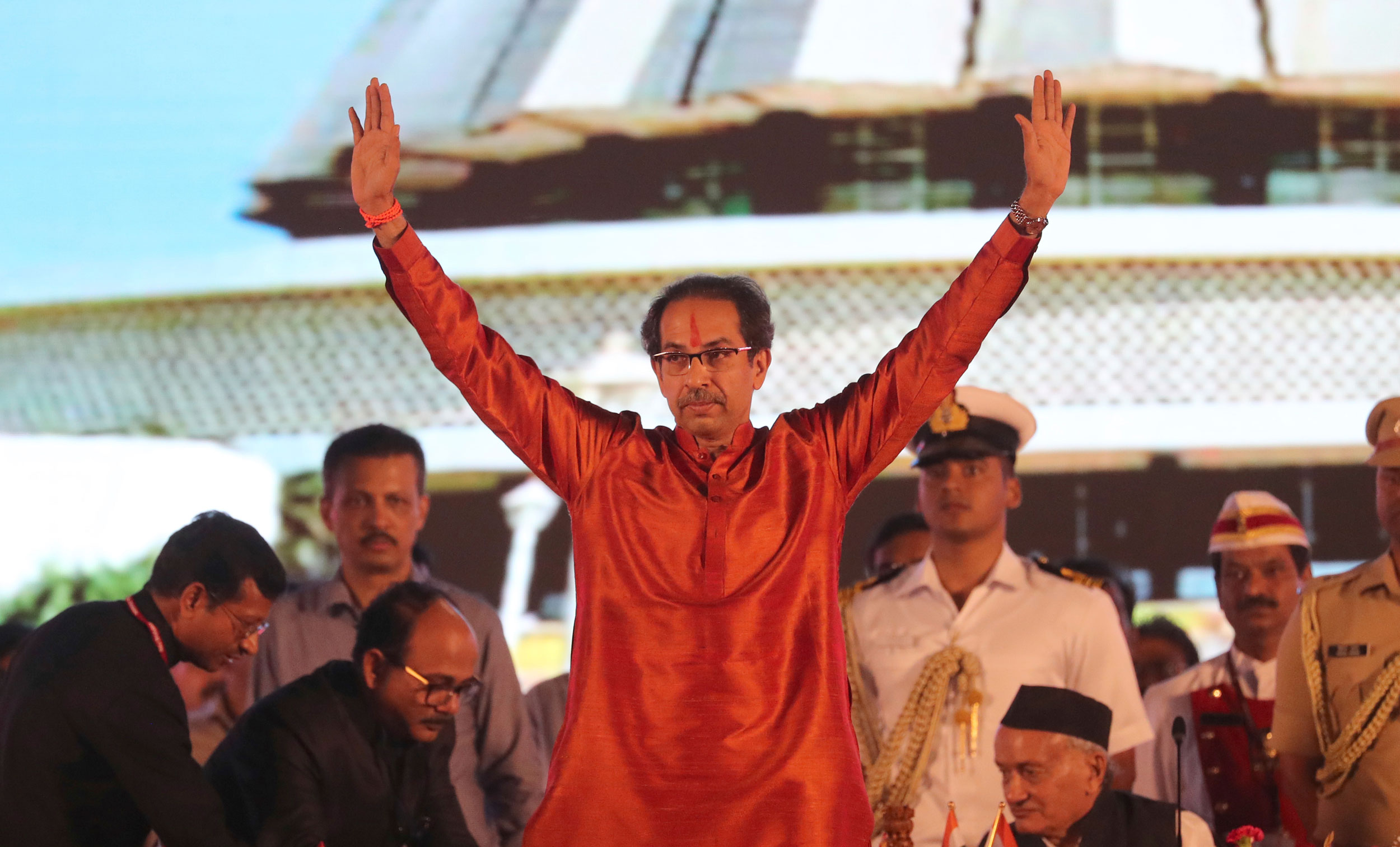 Shiv Sena chief Uddhav Thackeray greets the crowd after after taking oath as the chief minister of Maharashtra during the swearing-in-ceremony in Mumbai on Thursday.