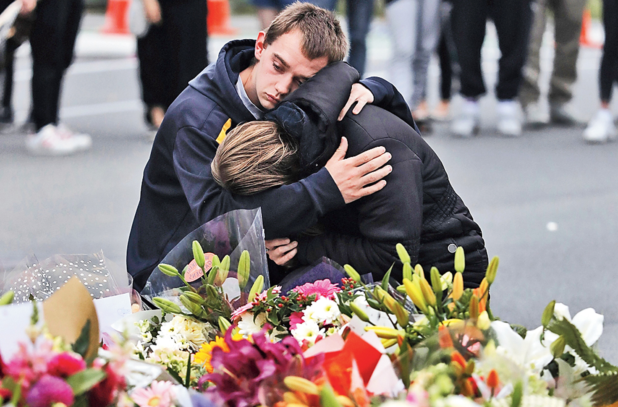 Mourners pay tribute near the Al Noor Mosque in Christchurch.