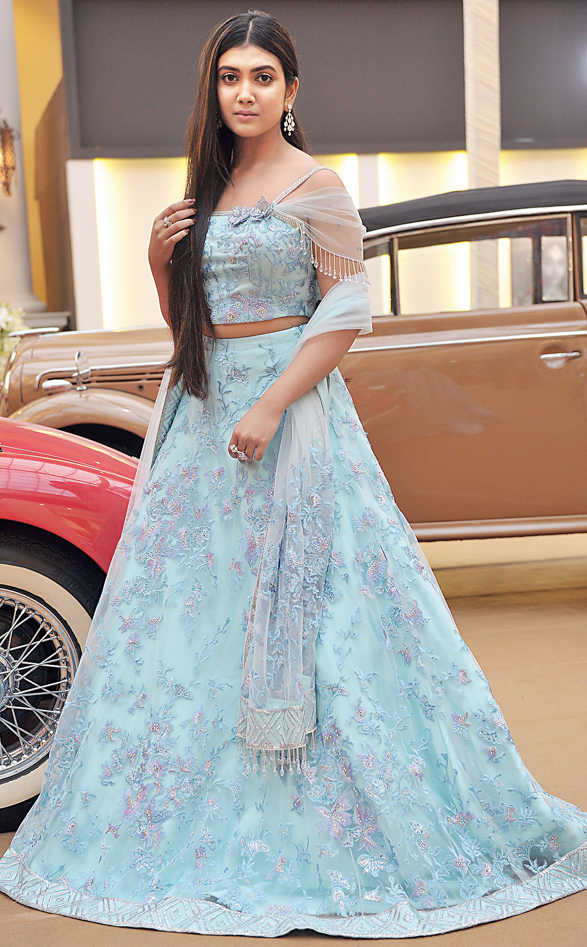 """An aqua net lehnga with silver sequins, crystals and thread embroidery. """"A little sexy, with tassels on one side, with 3D flowers… the colour is fresh and pretty and the embroidery light and quite effective. It is a nice festive look,"""" said Suneet Varma"""