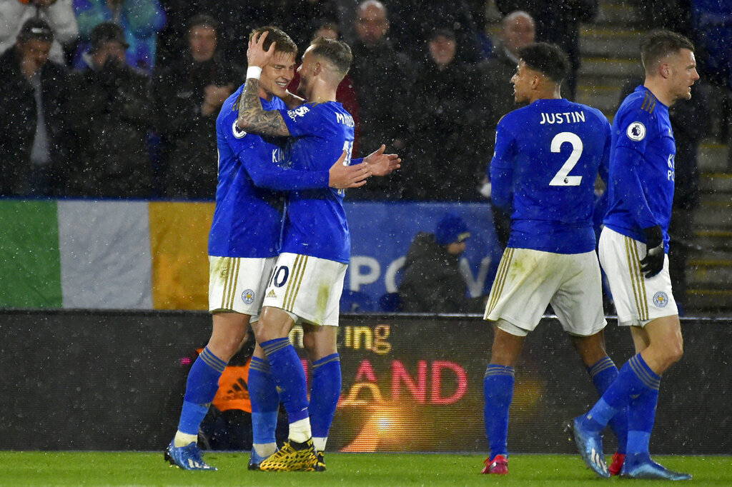 Harvey Barnes (left) celebrates with teammate James Maddison after scoring his side's fourth goal during the English Premier League football match between Leicester City and Aston Villa in Leicester on Monday