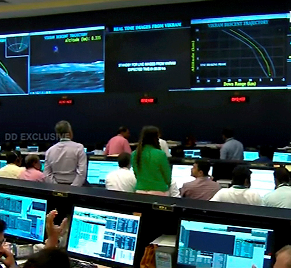 Officials watch live telecast of the soft landing of Vikram module of Chandrayaan 2 on lunar surface as it starts 'fine breaking' at ISRO Telemetry Tracking and Command Network (ISTRAC), in Bangalore on  Saturday, September 7, 2019.