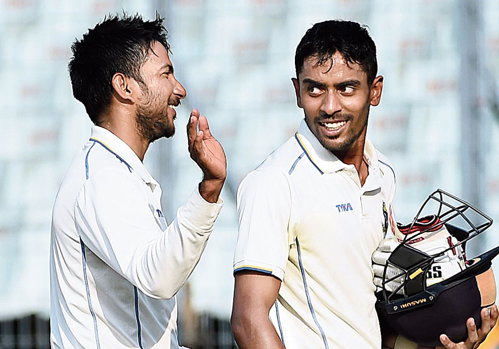 Abhimanyu Easwaran and Anustup Majumdar walk back to the pavilion after guiding Bengal to a 7-wicket win over Delhi, at the Eden, on Wednesday.